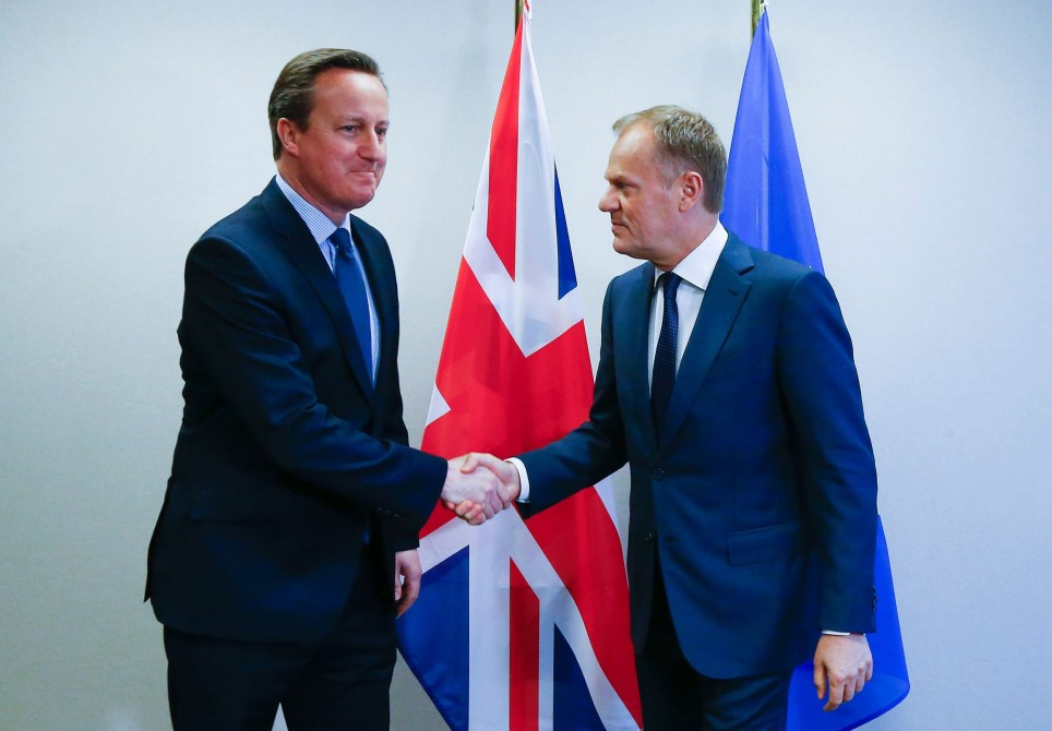 Britain's Prime Minister David Cameron (L) and European Council President Donald Tusk shake hands during a bilateral meeting ahead of an EU summit meeting, at the European Union headquarters in Brussels, on February 18, 2016. EU leaders head into a make-or-break summit sharply divided over difficult compromises needed to avoid Britain becoming the first country to crash out of the bloc. / AFP / POOL / YVES HERMAN (Photo credit should read YVES HERMAN/AFP/Getty Images)