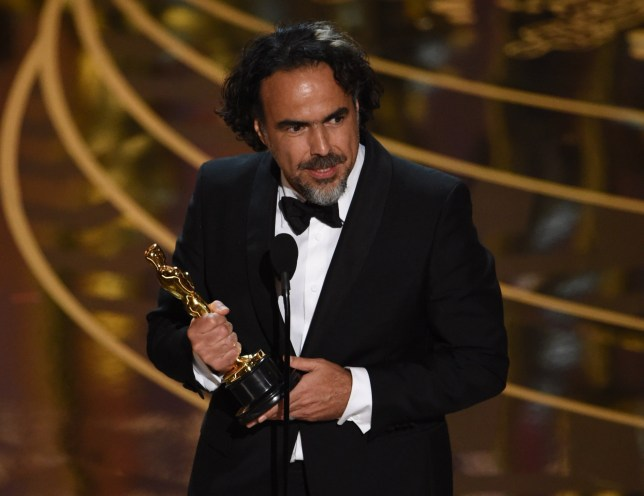 Director Alejandro Gonzalez Inarritu accepts his award for Best Director in The Revenant on stage at the 88th Oscars on February 28, 2016 in Hollywood, California. AFP PHOTO / MARK RALSTONMARK RALSTON/AFP/Getty Images