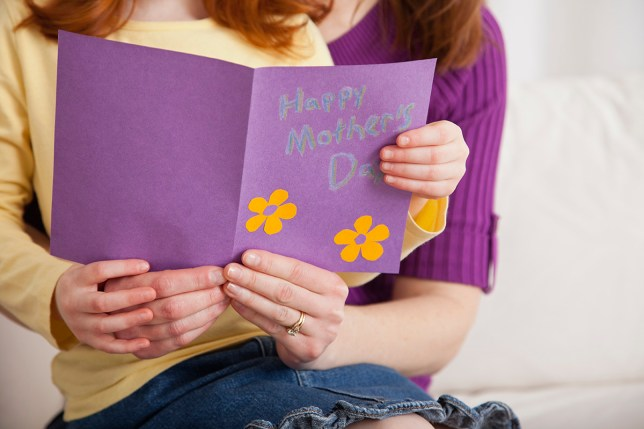 a nmother and child holding a mother's day card