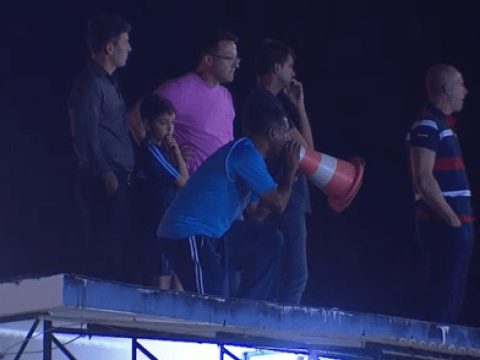 Uruguayan manager Sergio Ramirez uses traffic cone to shout at players after being sent to stands