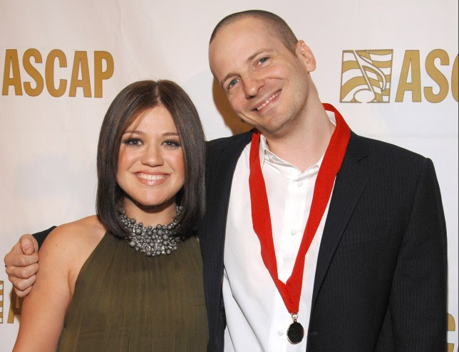 """Kelly Clarkson and Lukasz """"Dr. Luke"""" Gottwald during ASCAP Pop Music Awards at Kodak Theater in Los Angeles, California, United States. (Photo by Lester Cohen/WireImage for ASCAP)"""