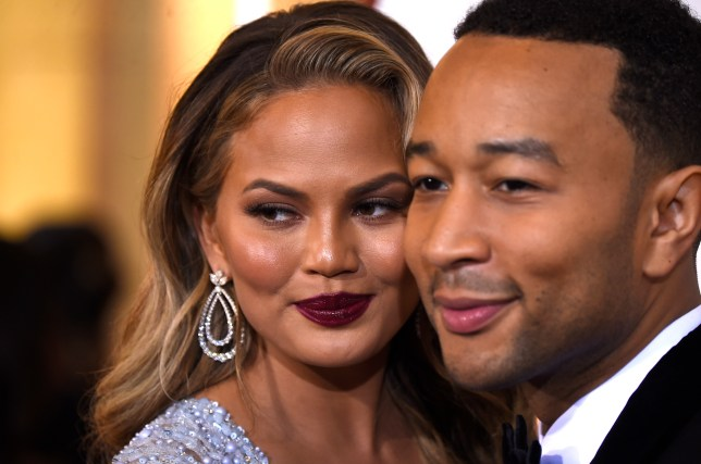 HOLLYWOOD, CA - FEBRUARY 22: Model Chrissy Teigen (L) and musician John Legend attend the 87th Annual Academy Awards at Hollywood & Highland Center on February 22, 2015 in Hollywood, California. (Photo by Frazer Harrison/Getty Images)