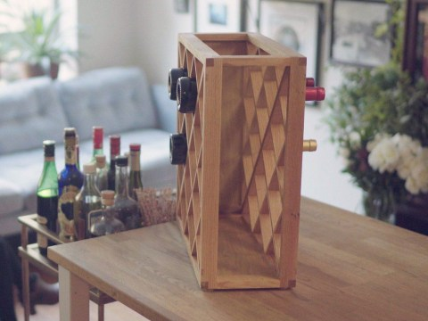 This magical wine rack makes bottles disappear