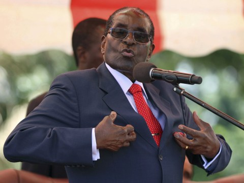Robert Mugabe threatens to punch reporter who asks if he's going to retire