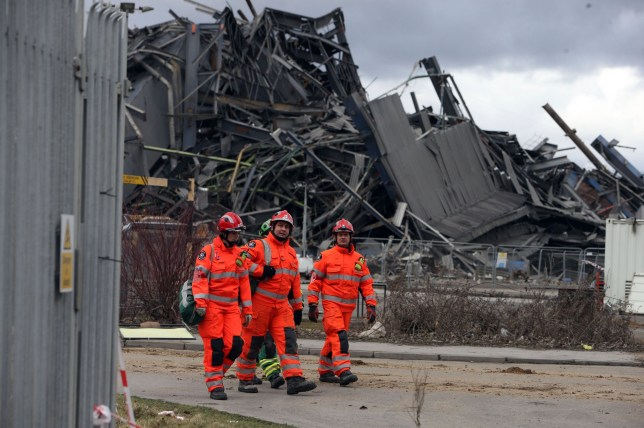 """File photo dated 3/3/2016 of rescue workers at the scene at Didcot Power Station, Oxfordshire, as a family member of one of the three men trapped under the rubble of the collapsed power station has called the delay in their rescue """"diabolical"""". PRESS ASSOCIATION Photo. Issue date: Monday March 7, 2016. Mike Collings, 53, was killed and three other demolition workers were buried and left unaccounted for when the structure folded nearly two weeks ago. Emergency services have since said it is """"highly unlikely"""" the missing are still alive and last week stated that the recovery operation could take months. See PA story POLICE Didcot. Photo credit should read: Steve Parsons/PA Wire"""