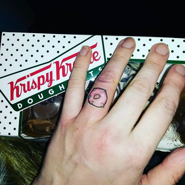 3d3529f93 PIC FROM MERCURY PRESS (PICTURED: KATY WEST, 36, SHOWS OFF HER DONUT