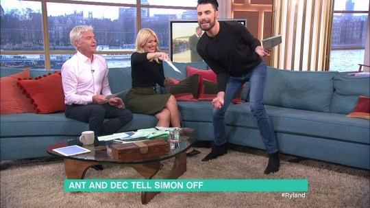 Rylan Clark freaks out after Holly brushes a moth off his shoulder on 'This Morning'. Broadcast on ITV1HD Featuring: Holly Willoughby, Phillip Schofield, Rylan Clark When: 09 Mar 2016 Credit: Supplied by WENN **WENN does not claim any ownership including but not limited to Copyright, License in attached material. Fees charged by WENN are for WENN's services only, do not, nor are they intended to, convey to the user any ownership of Copyright, License in material. By publishing this material you expressly agree to indemnify, to hold WENN, its directors, shareholders, employees harmless from any loss, claims, damages, demands, expenses (including legal fees), any causes of action, allegation against WENN arising out of, connected in any way with publication of the material.**