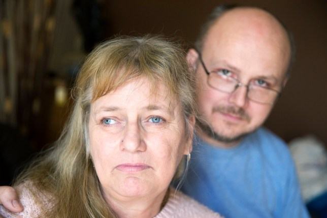 """Jane Windle pictured with her husband William. A terminally ill cancer patient has been stripped of her benefits by the Government because she is """"not disabled enough"""" and told to go back to WORK. See NTI story NTICANCER. Jane Windle, 52, is left in constant agony and can barely walk after being diagnosed with slow-growing carcinoid tumours in 2001. She was initially given six months to live but has defied medics to live for a further 15 years. But the crippling tumours in her lungs and pelvis have left her in excruciating pain whenever she stands up and she is constantly short of breath. Despite this, the Department of Work and Pensions (DWP) has told her she is no longer entitled to her £140-a-week Disability Living Allowance (DLA). The former petrol station worker was also devastated to be told her husband, William, 41, will no longer receive his £60-a-week carer's allowance. Yesterday (Thurs) Jane, from Northampton, said she felt like she was being punished for battling back against cancer."""