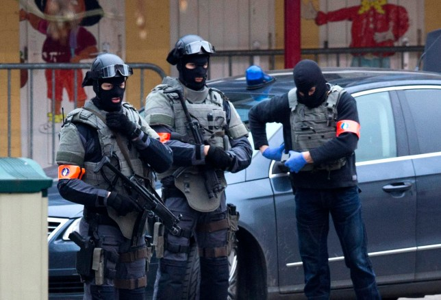 Special operations police secure an area during a police raid in the Molenbeek neighbourhood of Brussels, Belgium on Friday, March 18, 2016. Two French police officials have told The Associated Press that Salah Abdeslam, the main fugitive from Islamic extremist attacks in Paris in November, has been arrested in Belgium's capital after four months at large. He was arrested Friday in a major police operation in the Brussels neighborhood of Molenbeek. (AP Photo/Geoffrey Van der Hasselt)