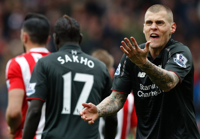 Liverpool's Slovakian defender Martin Skrtel (R) reacts after Referee Roger East (not pictured) showed him a yellow card following his challenge on Southampton's Italian striker Graziano Pelle (not pictured), and awarding Southampton a penalty during the English Premier League football match between Southampton and Liverpool at St Mary's Stadium in Southampton, southern England on March 20, 2016. / AFP PHOTO / ADRIAN DENNIS / RESTRICTED TO EDITORIAL USE. No use with unauthorized audio, video, data, fixture lists, club/league logos or 'live' services. Online in-match use limited to 75 images, no video emulation. No use in betting, games or single club/league/player publications. / ADRIAN DENNIS/AFP/Getty Images