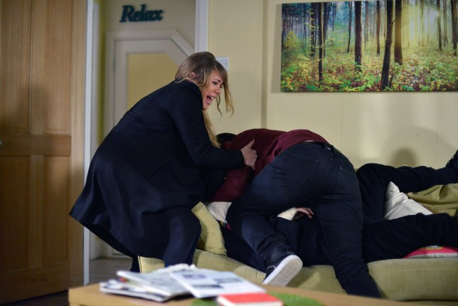 WARNING: Embargoed for publication until 00:00:01 on 22/03/2016 - Programme Name: Eastenders - TX: 29/03/2016 - Episode: 5254 (No. n/a) - Picture Shows: Sharon drags Ben away from Phil. Sharon Mitchell (LETITIA DEAN), Phil Mitchell (STEVE MCFADDEN), Ben Mitchell (HARRY REID) - (C) BBC - Photographer: Kieron McCarron
