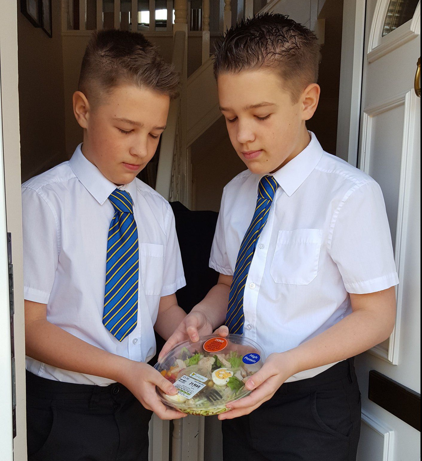 PIC FROM MERCURY PRESS (PICTURED: MATTHEW AND JAMES BAYLEY, 12, WITH THE ROAST CHICKEN & BROCCOLI SALAD THAT WAS DELIVERED TO THEM INSTEAD OF THE TWO EASTER EGGS THEIR MOTHER JOANNE BAYLEY HAD ORDERED) A mum claims a supermarket could be taking their ëhealthy eatingí drive too far ñ when she ordered her twin boys two Easter eggs but was delivered a SALAD. Joanne Bayley, 41, had treated 12-year-old twins Matthew and James to a Cadburyís Mini Eggs extra large egg each at a total price of £8.00 on her online shop with Tesco. However Joanne, who works in accounts, was left baffled when the supermarket giant switched the two eggs to a single roast chicken and broccoli salad for £3.50. Soon enough the twins heard about their mumís recent purchase and were asking Joanne if they were really going to be getting a salad for Easter. SEE MERCURY COPY