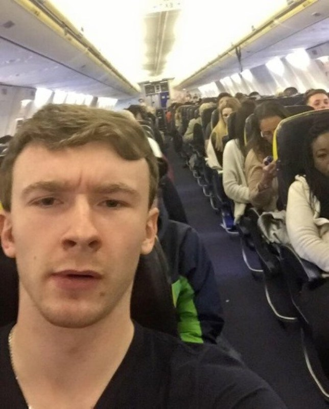 Alex Caviel on the flight to Barcelona after drinking in Chelmsford hours earlier. See Masons copy MNFLIGHT: A boozy reveller ended up £1,000 out of pocket after going on a night out in Essex - and waking up more than 900 miles away in Barcelona. Alexander Caviel, 21, downed a dozen Jagerbombs - a shot of liquer inside a glass of Red Bull, a £90 bottle of champagne and glasses of Disaranno and coke during a booze binge. He ended up popping into a fried chicken shop in Chelmsford in the early hours of Saturday morning when he spotted a bus heading for nearby Stansted airport. He claims he has no knowledge of getting on the bus and booking a £200 flight to Barcelona using his mobile phone.