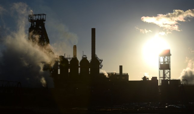The sun sets behind the Tata steel works in Port Talbot, Wales, as the steel giant confirmed plans to sell its UK assets, threatening thousands of job cuts. PRESS ASSOCIATION Photo. Picture date: Wednesday March 30, 2016. Unions reacted with shock and anger at the company's decision, taken at a board meeting in Mumbai. See PA story INDUSTRY Steel. Photo credit should read: Andrew Matthews/PA Wire