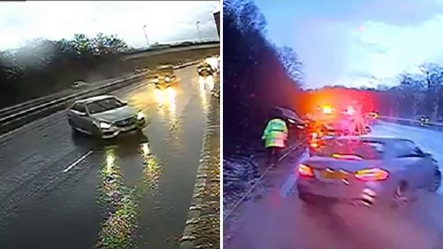 Police officer has VERY close call as car skids off motorway directly at them