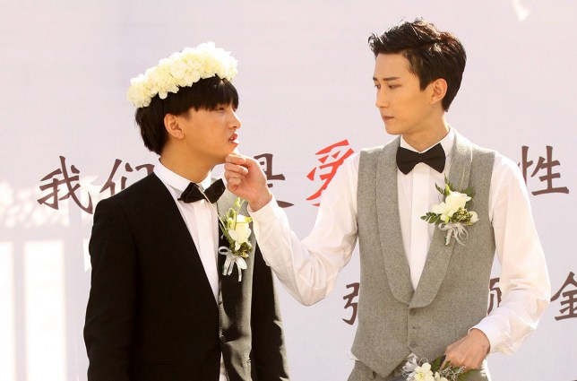 BEIJING, CHINA - OCTOBER 09: (CHINA OUT) Singer Jin Pujun (L) and singer Zhang Yunshuo on wedding ceremony on October 9, 2015 in Beijing, China. They are gay couples and get married on Friday in Beijing. (Photo by ChinaFotoPress/ChinaFotoPress via Getty Images)