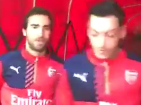 Arsenal's Mesut Ozil nutmegs Mathieu Flamini in the tunnel ahead of Watford match