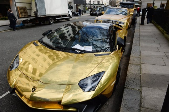 Three gold cars from Saudi Arabia (back-front) a 6x6 Mercedes G 63, Rolls-Royce Phantom Coupe and Lamborghini Aventador have received parking tickets on Cadogan Place in Knightsbridge, London. PRESS ASSOCIATION Photo. Picture date: Wednesday March 30, 2016. See PA story TRANSPORT Knightsbridge. Photo credit should read: Stefan Rousseau/PA Wire