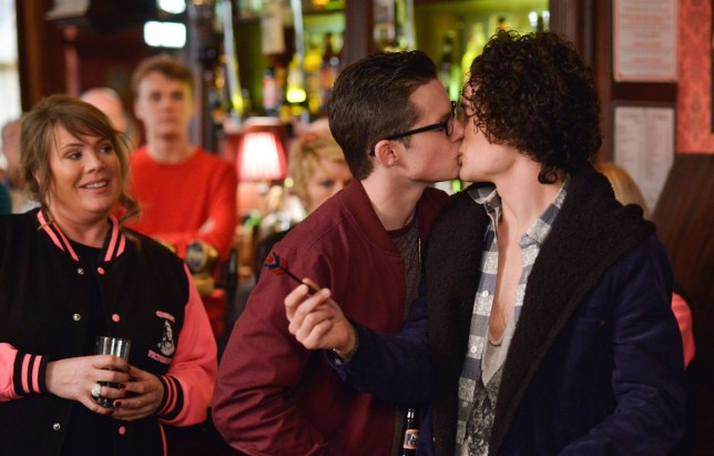 Programme Name: EastEnders - TX: 25/04/2016 - Episode: 5269 (No. n/a) - Picture Shows: Ben and Paul share a kiss. Everyone looks to Phil for his reaction. Sharon Mitchell (LETITIA DEAN), Johnny Carter (TED REILLY), Shirley Carter (LINDA HENRY), Ben Mitchell (HARRY REID), Paul Coker (JONNY LABEY) - (C) BBC - Photographer: Kieron McCarron