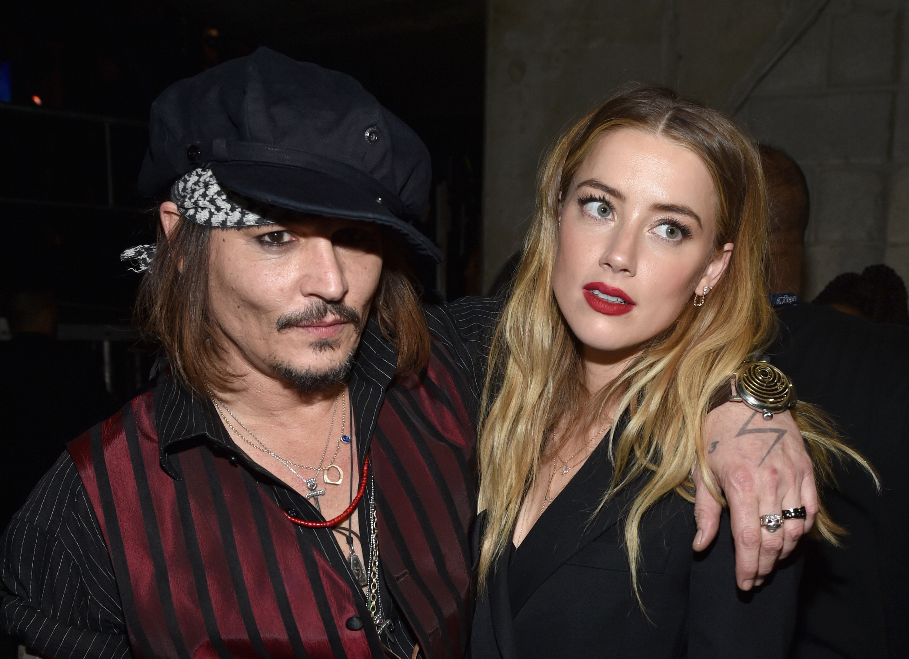 Johnny Depp and Amber Heard land in Australia to face dog smuggling charges