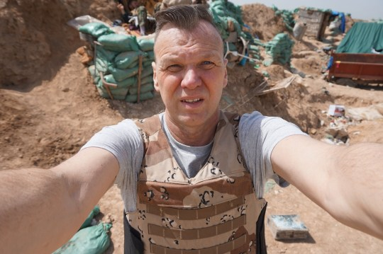 PIC BY MERCURY PRESS (PICTURED: ANDREW DRURY TAKING A SELFIE ON THE FRONT LINE NEAR KIRKUK) Married dad-Andrew Drury is a builder and WAR TOURIST who has just got back from a holiday being shot at by ISIS on the frontline in Iraq. Company director Andy, 50, from Guildford, Surrey, was dodging sniper bullets just a week ago in one of the most dangerous places on the planet. He is one of a brave or insane few who tour the world visiting war zones and disaster sites to see things most of us would be terrified to experience.¿ SEE MERCURY COPY