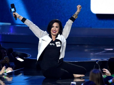 Demi Lovato has ANOTHER fall on stage, but carries on like a pro