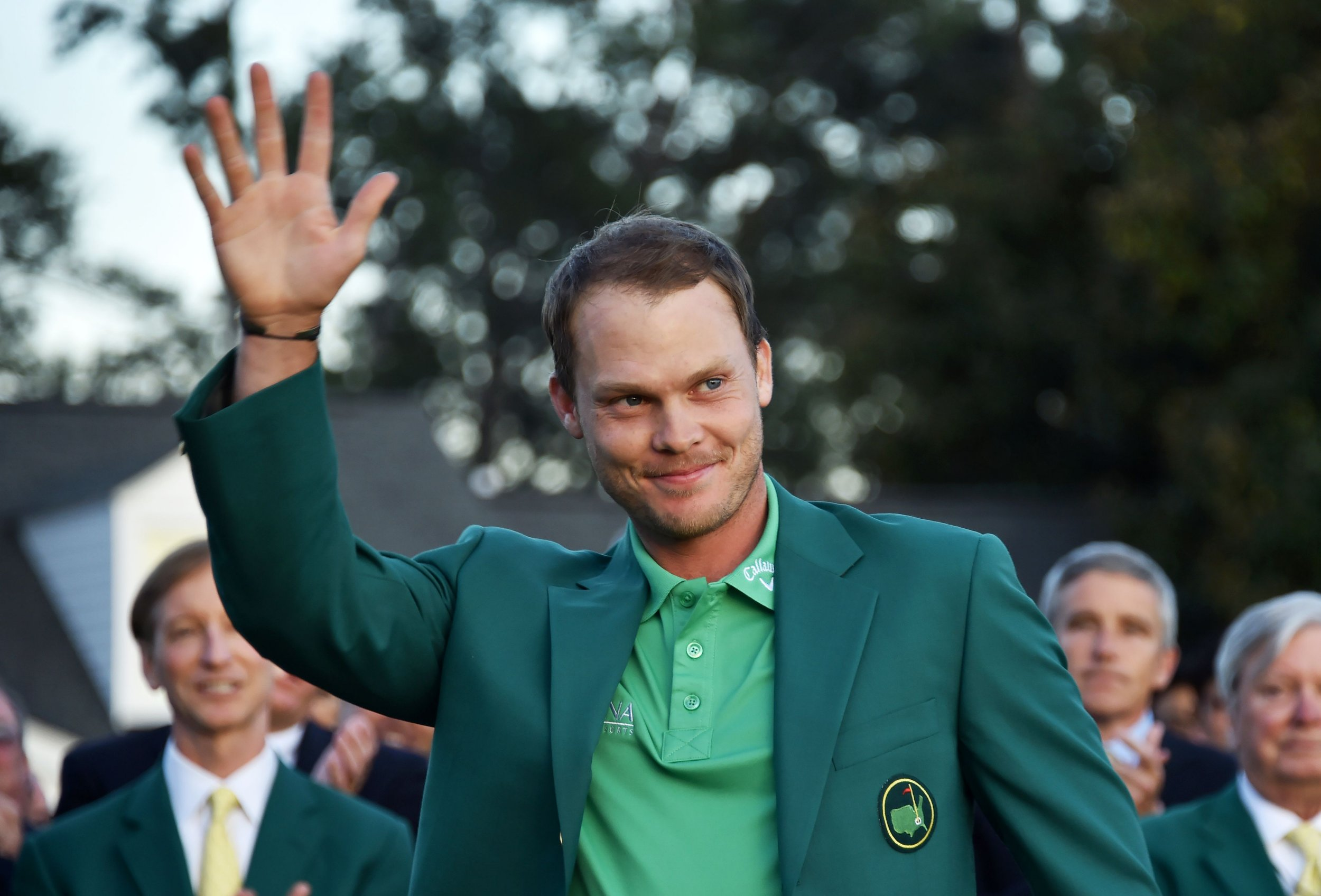 England's Danny Willett waves wearing the Green Jacket at the end of the 80th Masters Golf Tournament at the Augusta National Golf Club on April 10, 2016, in Augusta, Georgia. England's Danny Willett won the 80th Masters at Augusta National on Sunday for his first major title. He was trailing defending champion Jordan Spieth by five strokes around the turn, but stormed down the back nine to overhaul the American. Willett is the first Englishman since Nick Faldo 20 years ago to win the Masters and only the second all-time. / AFP PHOTO / Nicholas KammNICHOLAS KAMM/AFP/Getty Images
