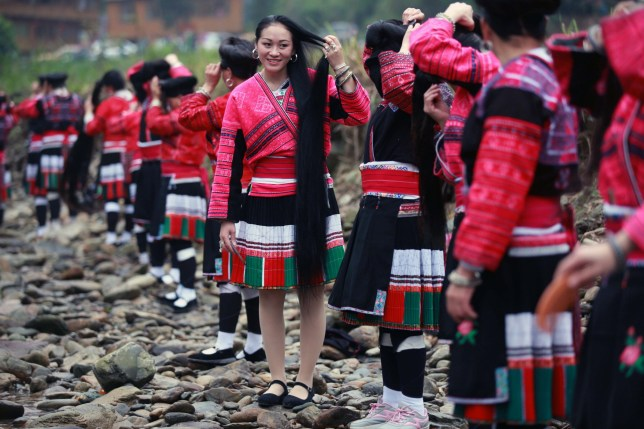 GUILIN, CHINA - APRIL 09: (CHINA OUT) Yao women comb hair during the Long Hair Festival at Longji Huangluo Yao Village on April 9, 2016 in Guilin, Guangxi Zhuang Autonomous Region of China. Yao people celebrated the first Long Hair Festival during the Double Third Festival on March 3 of the Chinese calendar. (Photo by VCG/VCG via Getty Images)