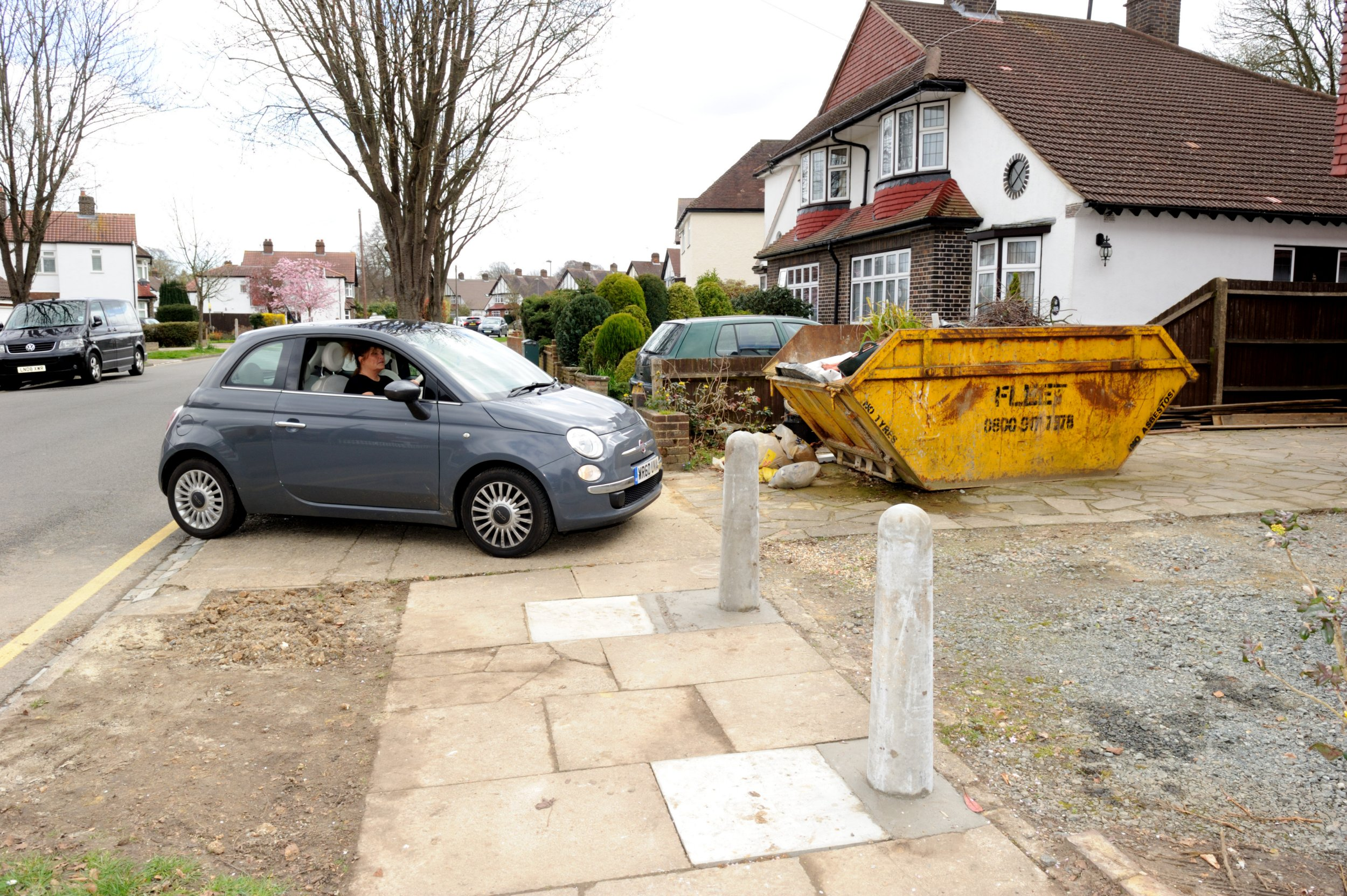 Council install concrete bollards to stop family from using own drive