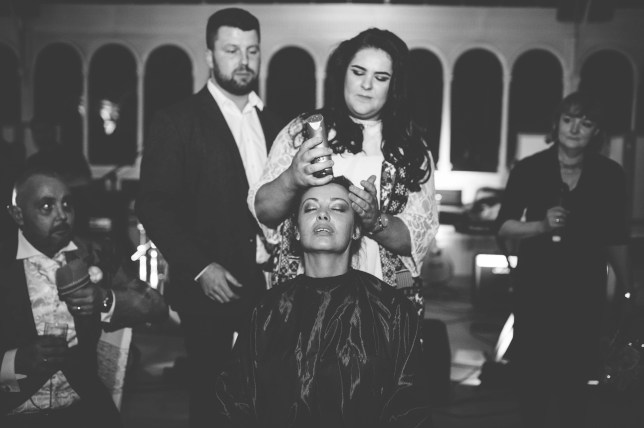 PIC FROM STRUTH PHOTOGRAPHY/MERCURY PRESS (PICTURED: Joan Lyons, 44, having her hair shaved off on her wedding day to pay tribute to her terminally ill husband Craig) A brave bride paid her terminally ill husband a touching tribute by shaving off her hair on her wedding night. Brunette Joan Lyons, 44, from Huyton, Liverpool, opted to shed her locks as she wed childhood sweetheart Craig, also 44, in a tear-jerking ceremony at the city's Isla Gladstone on Friday. Romantic Craig, who has terminal pancreatic cancer, confessed his love for previously-married Joan while aboard a ferry on the River Mersey 18 months ago after the pair met aged just 14. And the couple opted to bring their wedding plans forward after Craig learned that a tumour on the main pancreatic aorta was inoperable. SEE MERCURY COPY