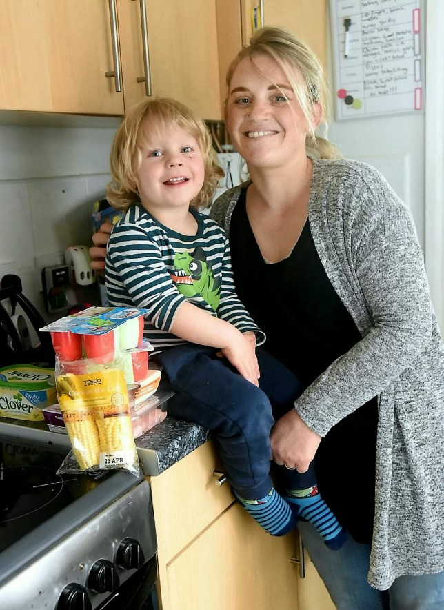 Harriet Stapley and her son Jack. See SWNS story SWCRAB; A mum was stunned when she opened her online Tesco delivery bag - to find a LIVE CRAB. Harriet Stapley, 30, found the tiny critter on top of a pack of yoghurt pots she'd bought for her young son. The crab was dropped off at her home along with bread, milk and other groceries by a Tesco delivery driver. The only fish amongst the order was a sealed packet of salmon.