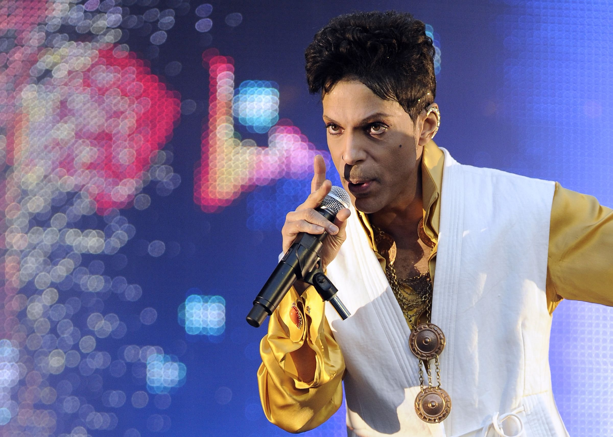 (FILES) This file photo taken on June 30, 2011 shows US singer and musician Prince performing on stage at the Stade de France in Saint-Denis, outside Paris. Pop icon Prince -- one of the most influential but elusive figures in music -- has died at his compound in Minnesota, entertainment website TMZ reported on April 21, 2016, citing unnamed sources. Local authorities said a death investigation was underway at Prince's Paisley Park complex, but did not give the identity of the fatality. / AFP PHOTO / BERTRAND GUAYBERTRAND GUAY/AFP/Getty Images
