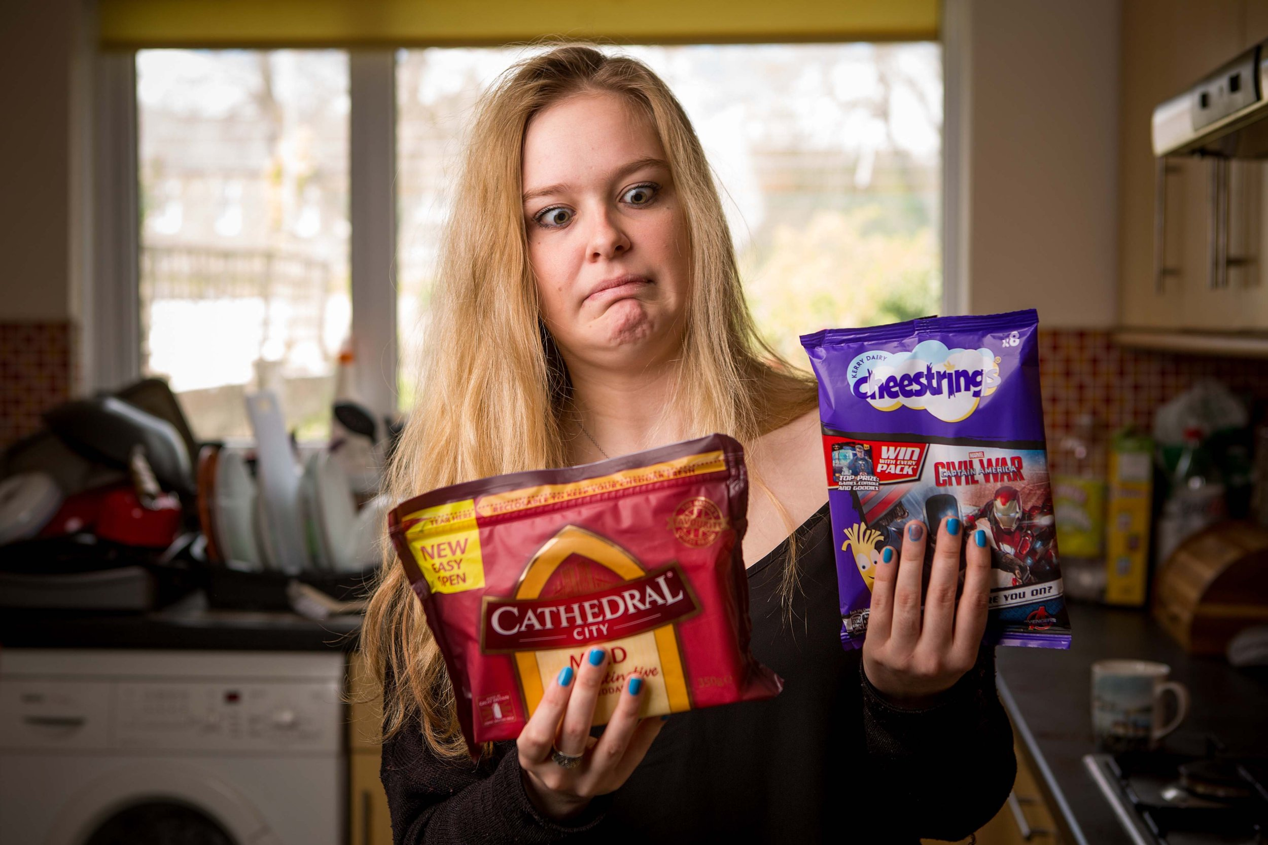 Katie Weston from Cardiff - who is scared of cheese. See SWNS story SWCHEESE; A student has warned her friends to tread caerphilly after she was tormented because of her fear - of CHEESE. Katie Weston, 20, has suffered from the unbrielievable phobia known as Turophobia, for as long as she can remember. The second year English literature student from Cardiff claims her fear is so damaging, she is left gagging at the smell of the dairy product. If she ever inadvertently tastes it, Katie has to run to the toilet to spit it out and then brush her teeth.
