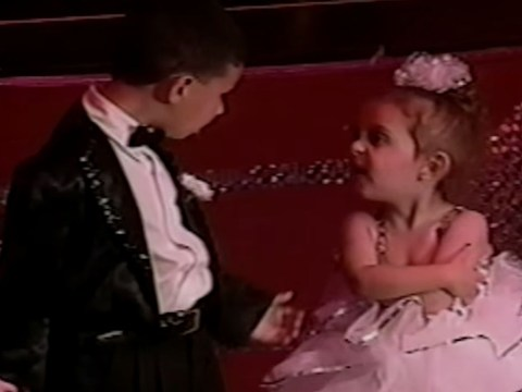 This little girl was so unimpressed with her assigned dance partner that she refused to dance with him at all