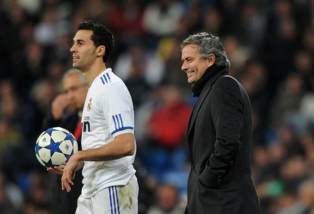 MADRID, SPAIN - FEBRUARY 02: Head coach Jose Mourinho of Real Madrid smiles as he stands by Alvaro Arbeloa of Real Madrid during the semi-final Copa del Rey second leg match between Real Madrid and Sevilla at Estadio Santiago Bernabeu on February 2, 2011 in Madrid, Spain. (Photo by Jasper Juinen/Getty Images)
