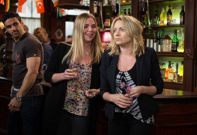 WARNING: Embargoed for publication until 00:00:01 on 31/05/2016 - Programme Name: EastEnders - TX: 06/06/2016 - Episode: EastEnders April - June 2016 - 5297 (No. n/a) - Picture Shows: *STRICTLY NOT FOR PUBLICATION UNTIL 00:01HRS, TUESDAY 31st MAY, 2016* As the girls play darts, Ronnie quizes Roxy on how things are with Andy. Kush Kazemi (DAVOOD GHADAMI), Ronnie Mitchell (SAMANTHA WOMACK), Roxy Mitchell (RITA SIMONS) - (C) BBC - Photographer: Jack Barnes