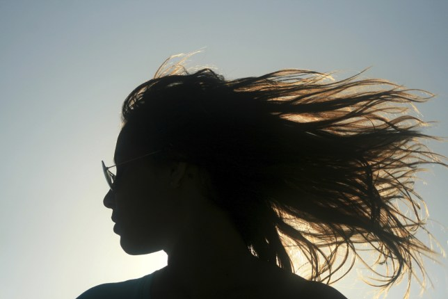 Mexico, Carmen Beach, Silhouette of woman's profile with windswept hair