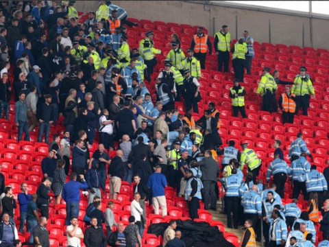 Millwall fans break through police barrier and begin 'charging' at Barnsley supporters