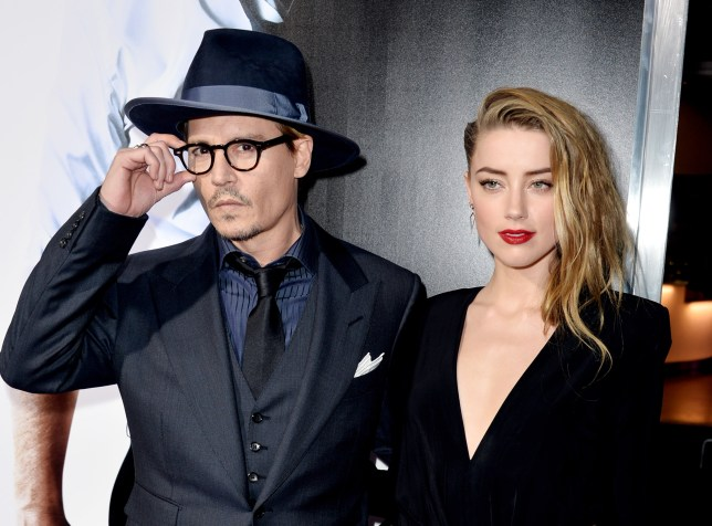 "LOS ANGELES, CA - FEBRUARY 12: Actor Johnny Depp (L) and his fiancee actress Amber Heard arrive at the premiere of Relativity Media's ""3 Days To Kill"" at the Arclight Theatre on February 12, 2014 in Los Angeles, California. (Photo by Kevin Winter/Getty Images)"