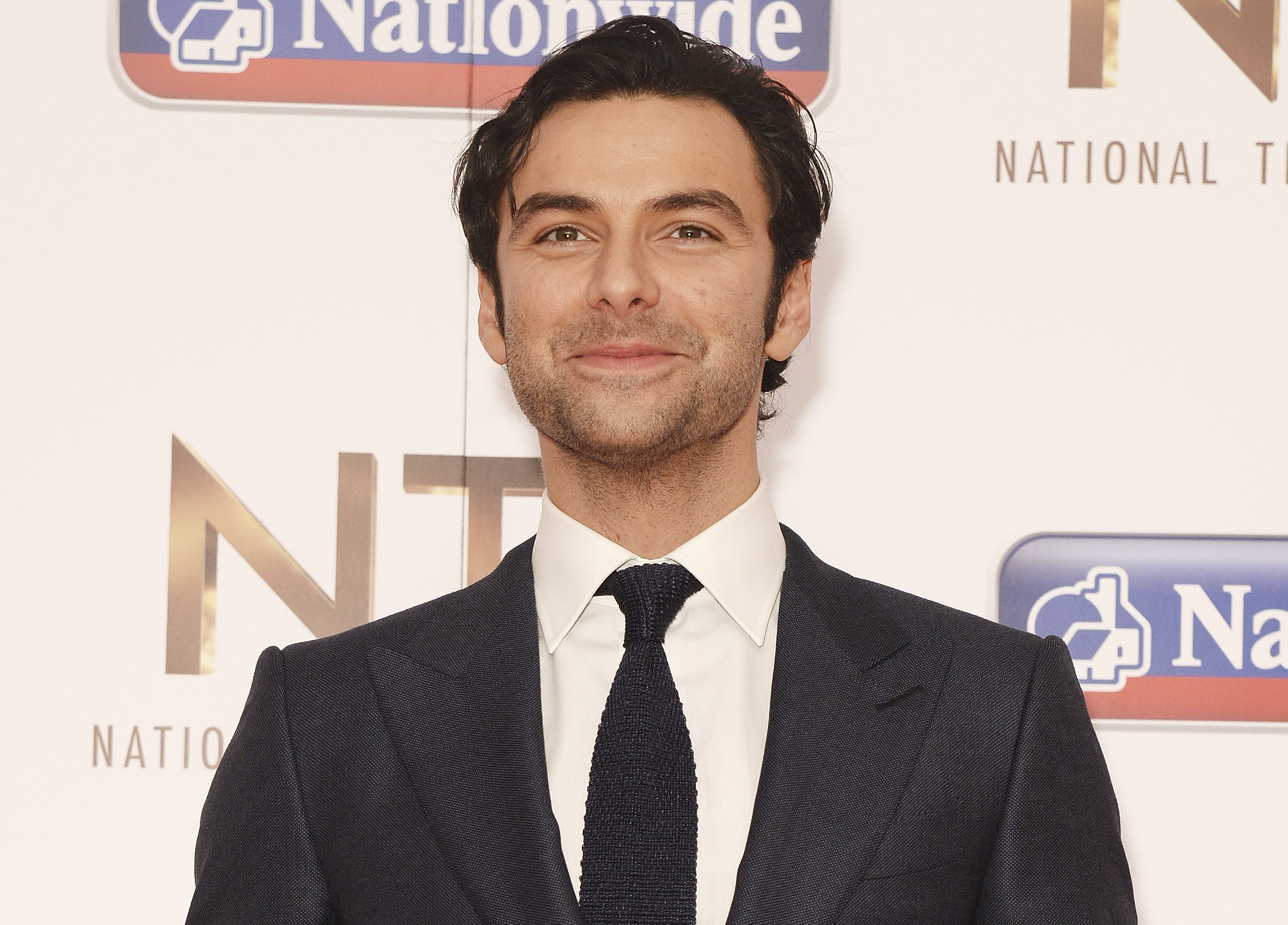 LONDON, ENGLAND - JANUARY 20: Aidan Turner, with the award for Impact/TV Moment, attends the 21st National Television Awards at The O2 Arena on January 20, 2016 in London, England. (Photo by Dave J Hogan/Dave J Hogan/Getty Images)
