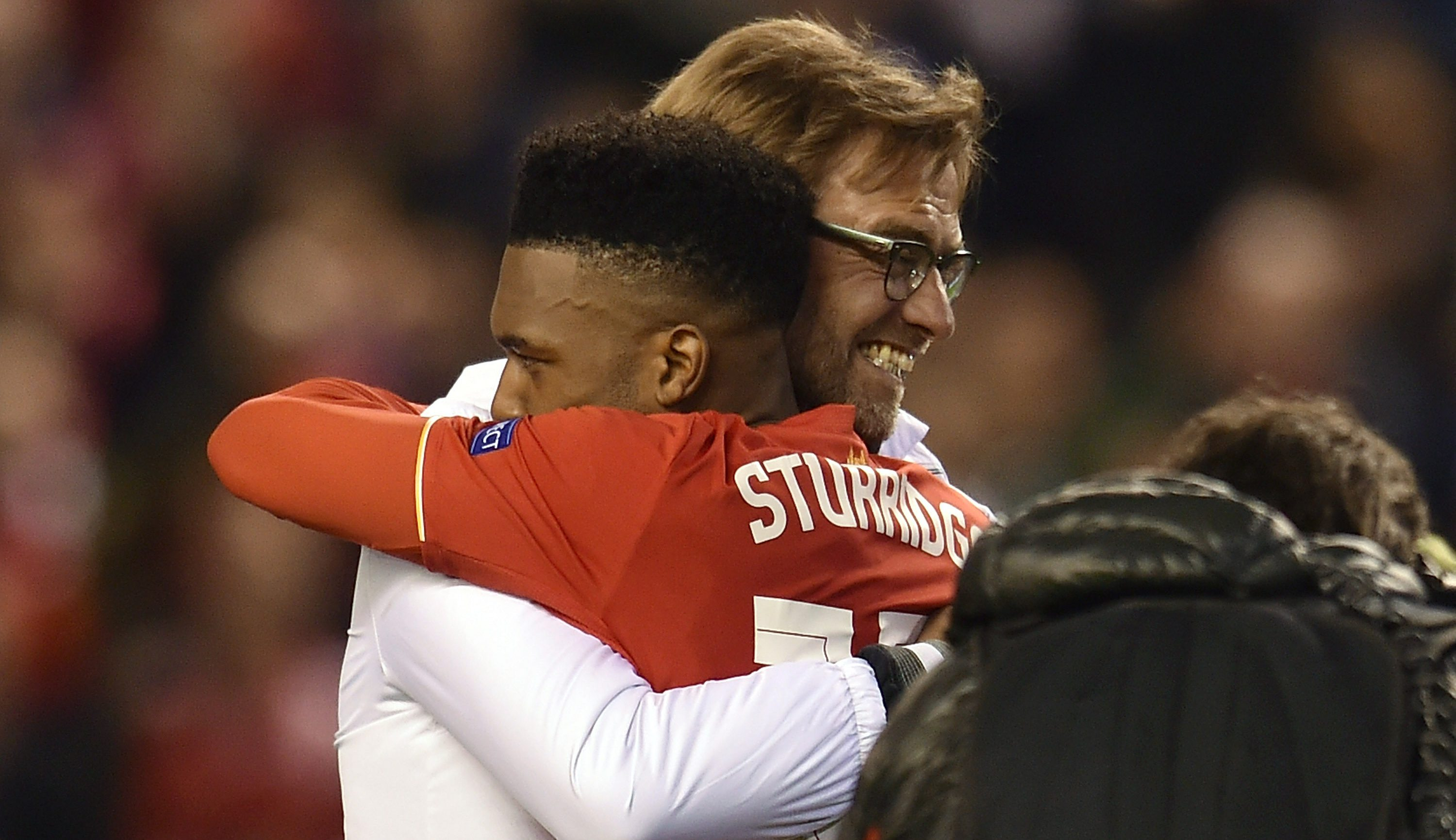LIVERPOOL, ENGLAND - MAY 05: (THE SUN OUT, THE SUN ON SUNDAY OUT) Jurgen Klopp manager of Liverpool embraces Daniel Sturridge at the end of the UEFA Europa League Semi Final: Second Leg match between Liverpool and Villarreal CF at Anfield on May 05, 2016 in Liverpool, England. (Photo by Andrew Powell/Liverpool FC via Getty Images)