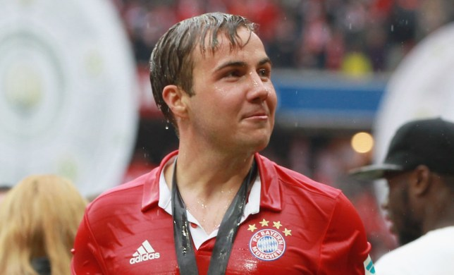 MUNICH, GERMANY - MAY 14: Mario Goetze of Bayern Muenchen smiles after he received a beer shower during the German Championship celebration after the Bundesliga match between FC Bayern Muenchen and Hannover 96 at Allianz Arena on May 14, 2016 in Munich, Germany. (Photo by A. Beier/Getty Images for FC Bayern )