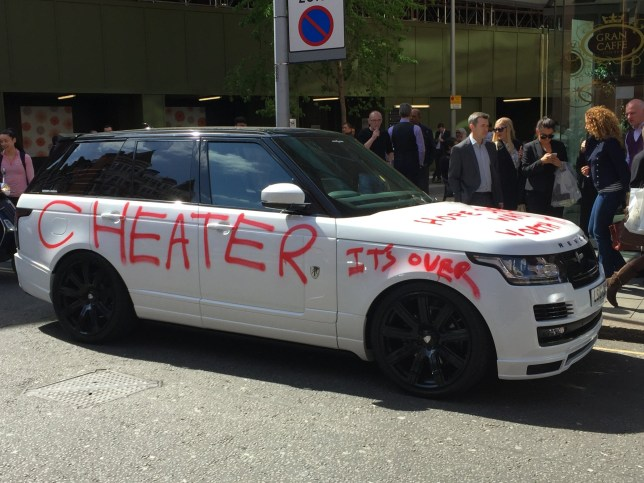 "This Range Rover driver will have more to worry about than a parking ticket, after £90,000 the car was daubed in graffiti calling them a CHEATER. See SWNS story SWCHEAT; The brilliant white car was covered in red spray paint on almost every body panel, including ""hope she was worth it"" painted over the back window. Along both sides of the 16 plate Range Rover Vogue, the word 'cheater' was painted in foot-high bright red letters, with 'it's over' added over the driver's side front wheel. The suspected love cheat will no doubt be left red-faced when they return to their brand new motor, because it also has 'hope she was worth it' sprayed on the bonnet."