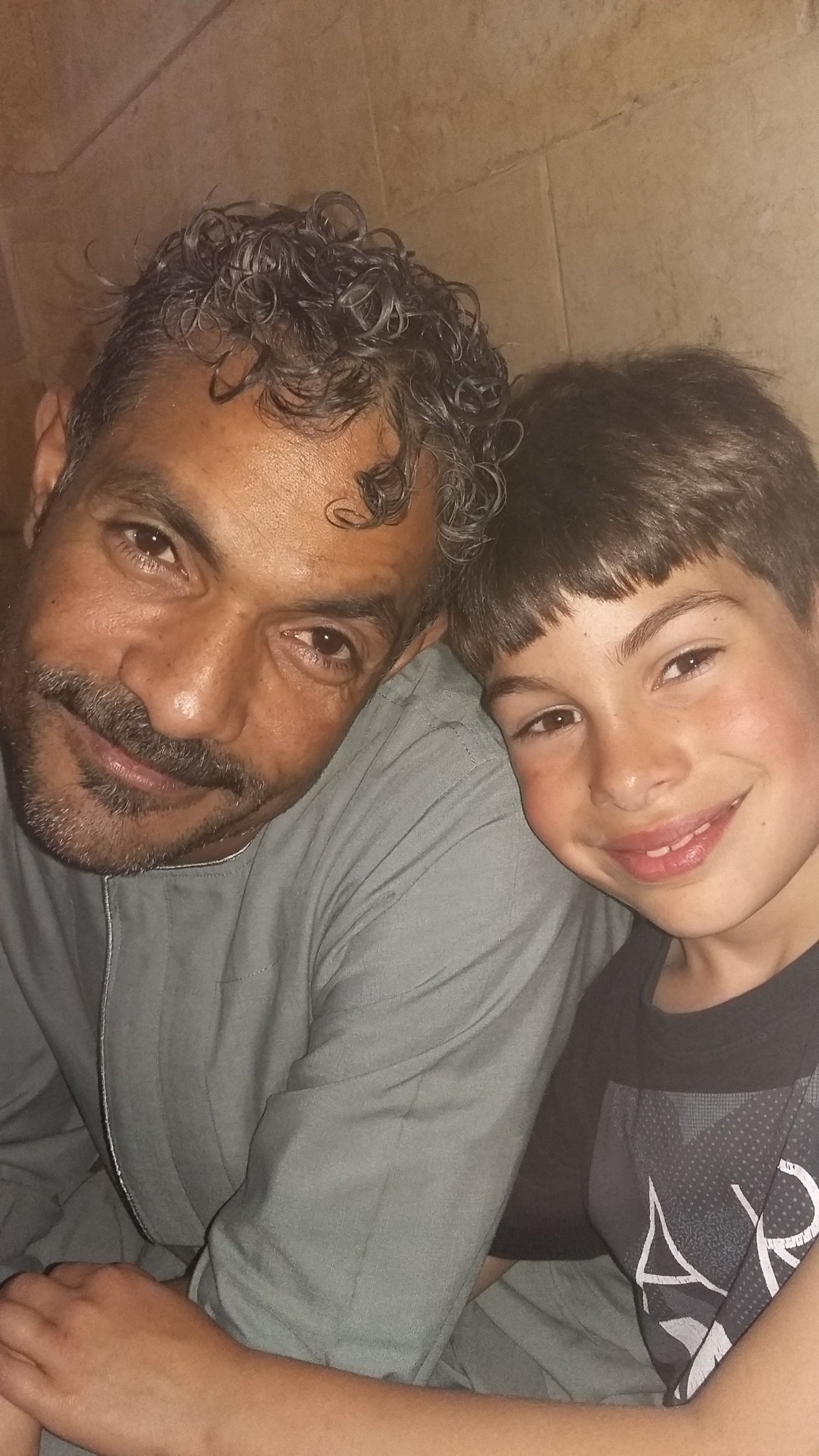Solomon, 9, with his Eygptian father Ibrahim. See National News story NNSCHOOL; A mum has criticised two schools for fining her after she took her sons to Egypt during term time to visit their dying grandmother. Mandie Ibrahim filled in a permission form for her sons Solomon and Louis to take seven days out of school to make the emergency visit. Yet when she returned from the trip, she discovered that both St Leonardís CofE Primary School and Ark William Parker Academy had fined her a combined total of £120. Mandie, of Hastings, East Sussex, said: ìAll we did while we were over there was go in and out of familyís home, visiting family.