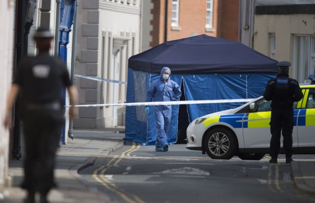 BRECON, WALES - MAY 08: A police forensic officer investigates the scene after a soldier died on his way to hospital having been found injured and unconscious in the town centre on May 08, 2016 in Brecon, United Kingdom. The soldier was found unconcious in the early hours of this morning on Lion Street in the Welsh town of Brecon. The death is being treated as 'unexplained', with reportedly no initial indications that the incident has links to terrorism.  (Photo by Matthew Horwood/Getty Images)