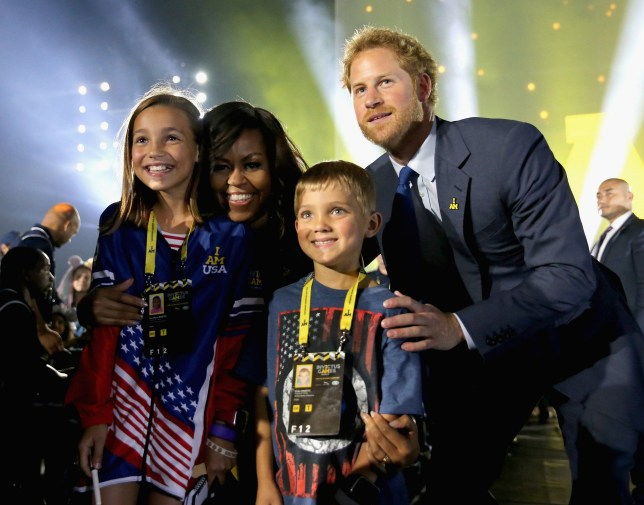 ORLANDO, FL - MAY 07: Prince Harry and Michelle Obama meet children of servicemen and women during the Opening Ceremony of the Invictus Games Orlando 2016 at ESPN Wide World of Sports on May 8, 2016 in Orlando, Florida. Prince Harry, patron of the Invictus Games Foundation is in Orlando ahead of the opening of Invictus Games which will open on Sunday. The Invictus Games is the only International sporting event for wounded, injured and sick servicemen and women. Started in 2014 by Prince Harry the Invictus Games uses the power of Sport to inspire recovery and support rehabilitation. (Photo by Chris Jackson/Getty Images for Invictus)