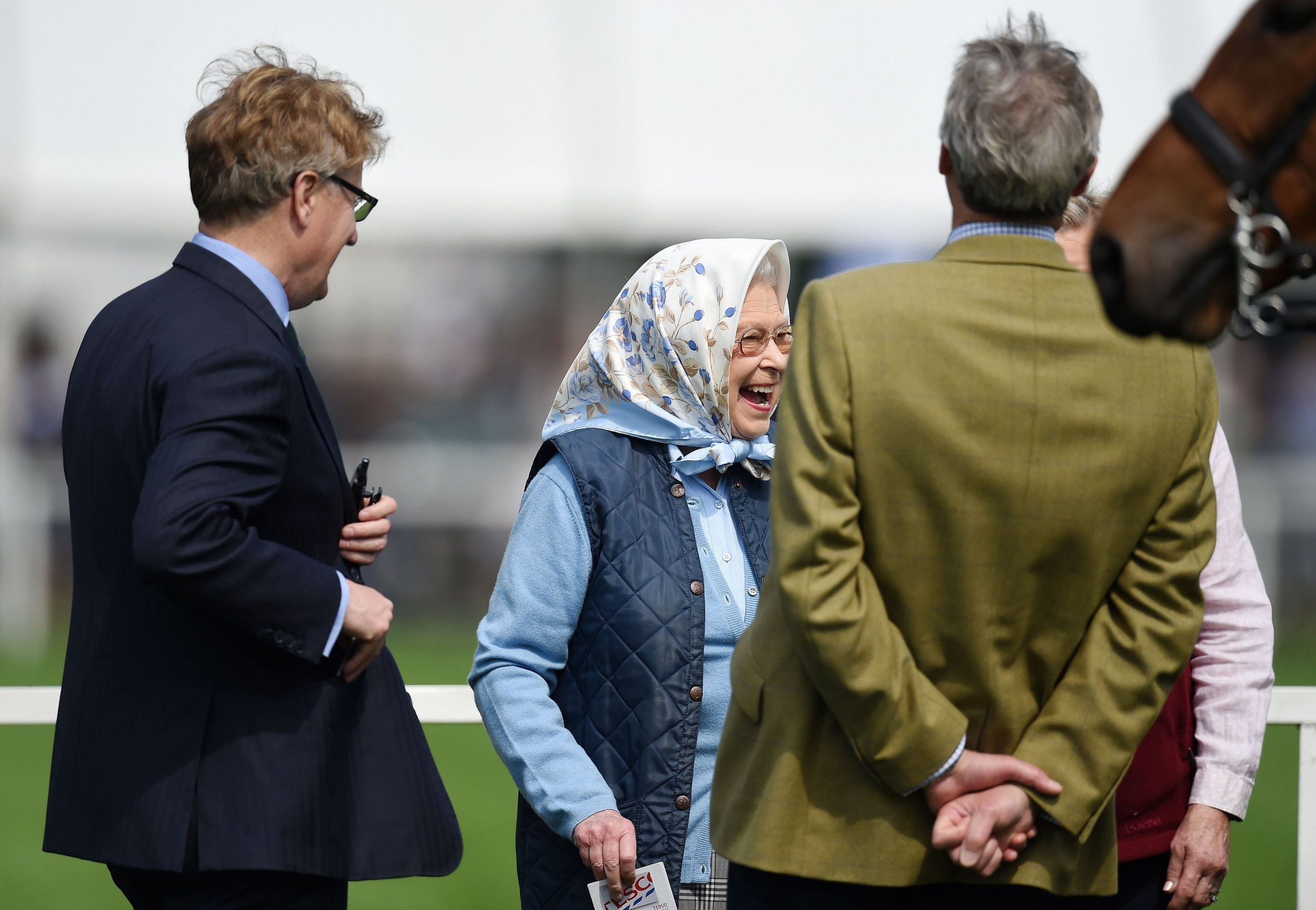 Queen Elizabeth II reacts after receiving Tesco vouchers after her horse Barber's Shop won the Tattersalls & RoR Thoroughbred Ridden Show during the Royal Windsor Horse Show, which is held in the grounds of Windsor Castle in Berkshire. PRESS ASSOCIATION Photo. Picture date: Thursday May 12, 2016. Photo credit should read: Andrew Matthews/PA Wire