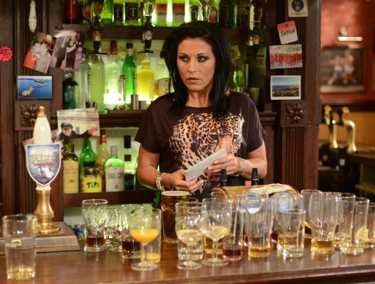 Television Programme: EastEnders with Kat Moon (JESSIE WALLACE) - TX: 05/10/2012 - Episode: 4509 (No. 4509) - Embargoed for publication until: 25/09/2012 - Picture Shows: Kat spots an envelope addressed to her on the bar. Kat Moon (JESSIE WALLACE) - (C) BBC - Photographer: Kieron McCarron