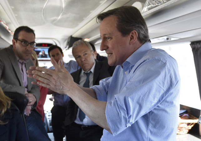 Britain's Prime Minister and leader of the Conservative Party, David Cameron, speaks with journalists on the Conservative Party 'battle bus' whilst campaigning in northern England, April 21, 2015. Britain goes to the polls to elect a new parliament on May 7. AFP PHOTO / POOL / TOBY MELVILLE (Photo credit should read TOBY MELVILLE/AFP/Getty Images)