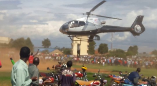 Helicopter mourner Credit: YouTube / David Fwamba